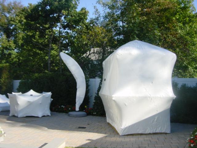 Tiki Huts and large outdoor umbrella winter storage